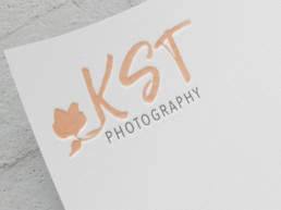 KST Photography logo on paper